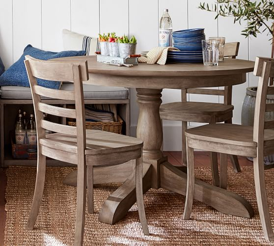 Shop Owen Round Pedestal Extending Dining Table from Pottery Barn on Openhaus