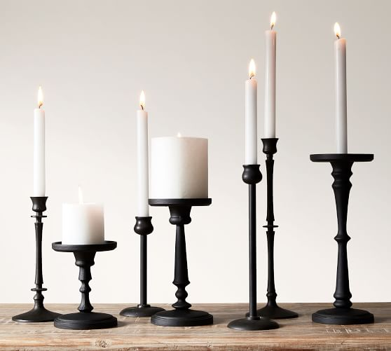 Four Candlestick Holders